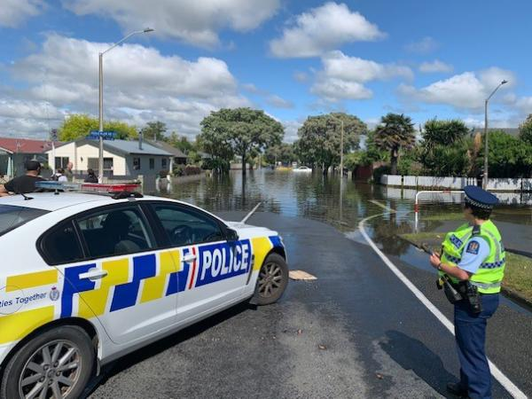 Constable Hazel Mitchell on the edge of flooding in the suburb of Marewa.