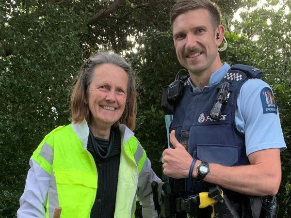 Constable Josh Furze with Catherine Martin in her new high-vis vest.