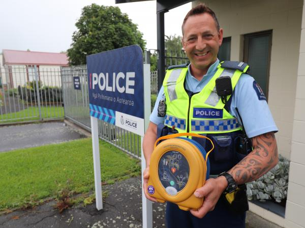Constable Nick Preston with the defibrillator he sourced for police in Te Aroha.