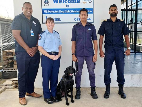 Inspector Sue Douglas, CO Faraaz Faizal Khan and Luey, with Corporal Mosese Fatiaki (left) and Principal Customs Officer Amit Ra