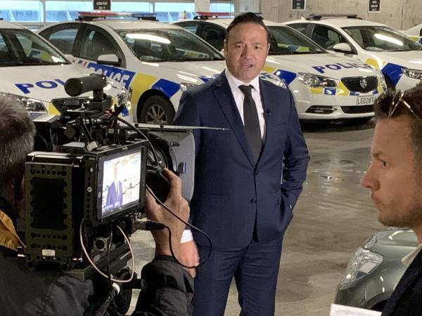 Detective Sergeant Rob Lemoto and Police Ten 7 crew filming in Wellington.
