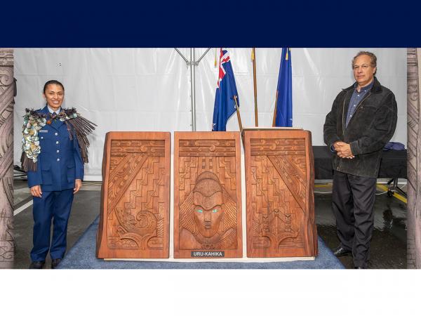 Area Commander Inspector Tracey Thompson and master carver Hermann Salzmann with Uru-Kahika.