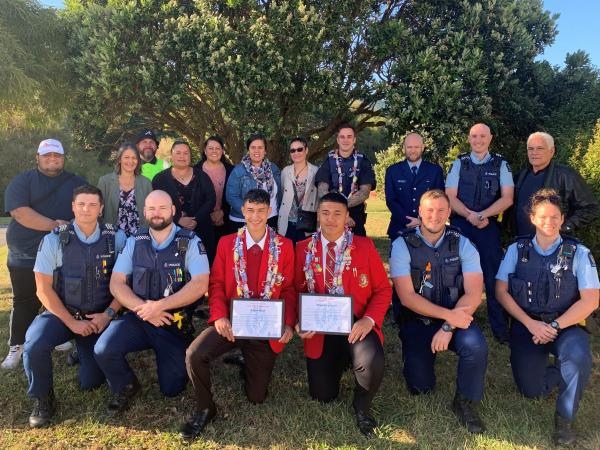 Rob and Oliver pictured with their whānau and staff from Porirua's Public Safety Team.