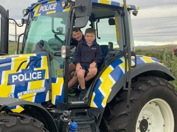 Reid Cathcart and friend in the police tractor.
