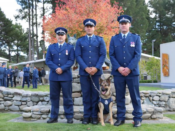 Constable Moses Gunn and Helo flanked by Sergeant Brett Marley (left), their Wellington Dog Section trainer, and Sergeant Blair