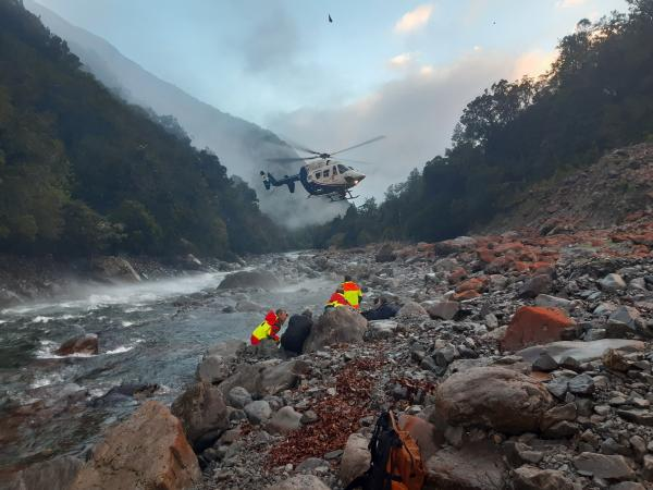 A helicopter arrives at Deception River in Westland to transport a rescued group to safety.