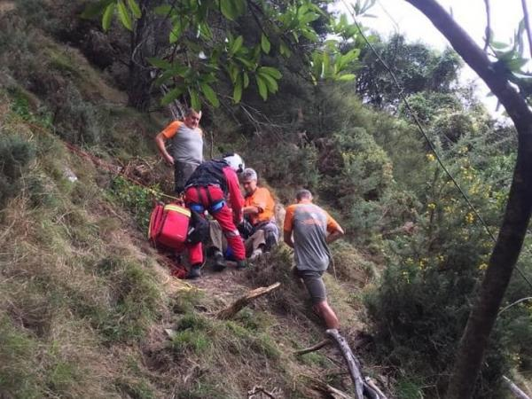 Rescue teams come to the aid of an injured hunter after a fall in Waikawa, Picton.