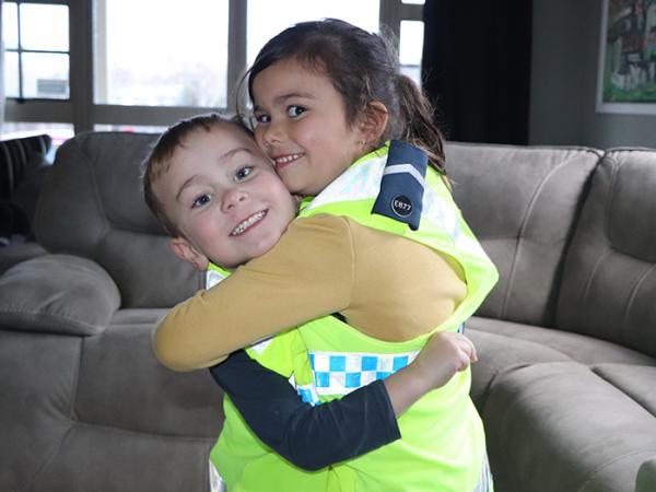 Beauden and Kiera having some fun with John's high-vis vest. Photo: Jill Reid.
