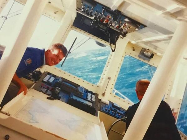 Image shows Tex and Maritime unit colleague in the launch control centre, early in his career, sailing on a clear blue day.