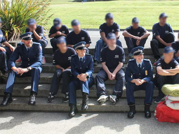 Rob and colleagues with young graduates from a life skills course at Whangaparoa.