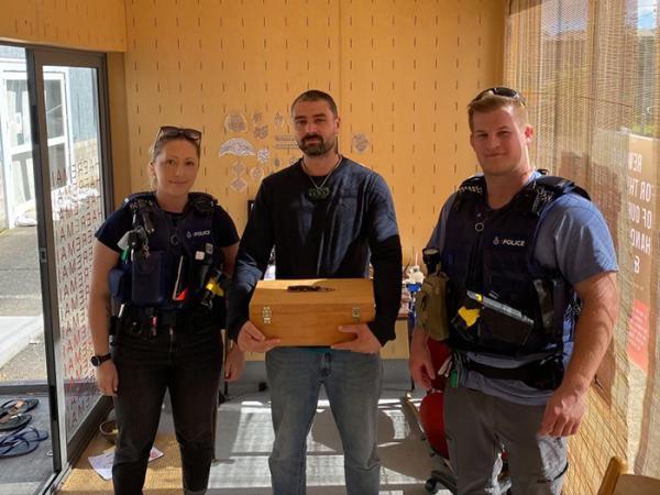 Constables Josh Downes and Jamie Allingham return Moko's tools.