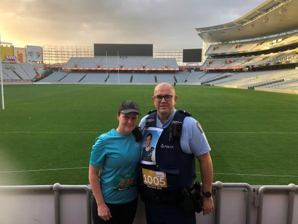 Senior Constable Justin Moore and his wife Laurelle after completing the 5,000 Step Up challenge at Eden Park.