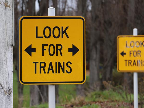 'Look for trains' signs