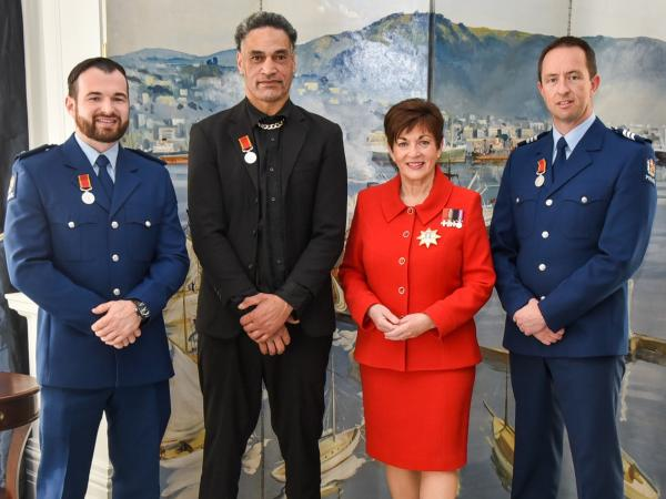 Constable Higby and two other Royal Humane Society medal recipients with Governor-General Dame Patsy Reddy.