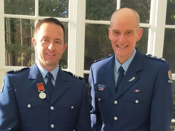 Sergeant Brett Neal and his supervisor at the time, Inspector Ash Tabb, at Government House for the award presentation.