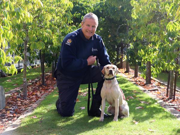 Senior Constable Grant Diver and his detector dog, Peyton.