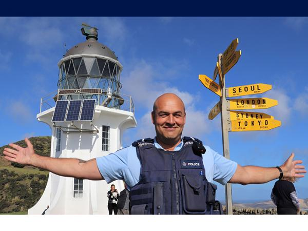 Senior Constable Leon Shepherd in front of the lighthouse at Cape Reinga