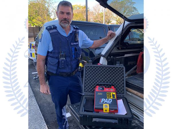Senior Constable Brad Clark with the AED he used to save a man's life.