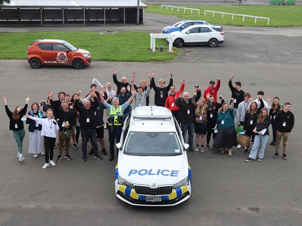 Course participants take a moment to strike a pose at the circuit.