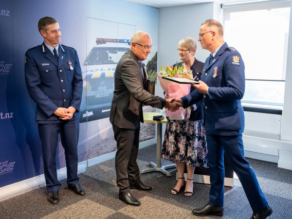 Commissioner Coster and Jo look on as Olaf receives his Certificate of Service from Southern District Commander Paul Basham.