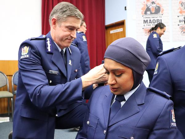 Commissioner Andy Coster and Constable Zeena Ali at her attestation ceremony in November 2020.