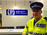 Police Recruit - now Constable - Josh Pollero checks out his old desk at PNHQ