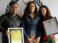 Te Roera and Caroline with Awa - and the Wellington Pride Awards she won in 2015 for her YouTube videos.