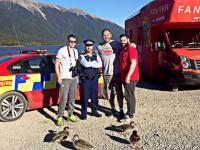 Constable Wayne Tilsley with some of the Lions faithful on the road. And some ducks.