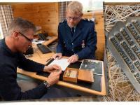 Senior Constable Aaron Smith and US Ambassador Scott Brown study the artefacts.