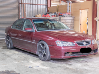Maroon Holden Commodore