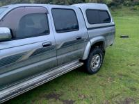 2004 silver/grey-coloured Toyota Hilux