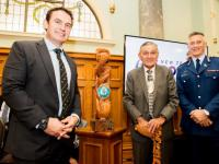 Police Minister Stuart Nash, King Tūheitia Paki and Commissioner Mike Bush with Te Pae Oranga pou.