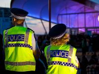 Policing at a concert venue, dusk