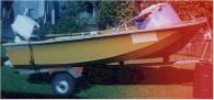 4 metre Boston Whaler. Orange/brown colo